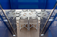 Dining table set on deck aboard Nativa, Monaco Yacht Show, Monaco, 30 September 2016. Nativa is a 48 m sailing vessel being sold by Fraser Yachts for €14.9 million.