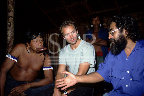 Capoto, Brazil. Sting with Chief Raoni of the Megranoti-Kayapo and Olympio Serra; Nov 1990.