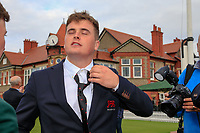 James Sugrue (GB&I) trying on the team USA tie during the opening ceremony at the Walker Cup, Royal Liverpool Golf CLub, Hoylake, Cheshire, England. 06/09/2019.<br /> Picture Fran Caffrey / Golffile.ie<br /> <br /> All photo usage must carry mandatory copyright credit (© Golffile | Fran Caffrey)