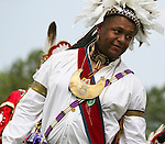 A Native American man dances in full traditional regalia at the 8th Annual Redwing PowWow in Virginia Beach, Virginia.