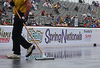 Apr. 27, 2013; Baytown, TX, USA: NHRA safety safari officials attempt to dry the track during a rain delay to qualifying for the Spring Nationals at Royal Purple Raceway. Mandatory Credit: Mark J. Rebilas-