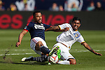 07 December 2014: Los Angeles's AJ De Le Garza (right) makes a stop against New England's Charlie Davies (left). The Los Angeles Galaxy played the New England Revolution in Carson, California in MLS Cup 2014. Los Angeles won 2-1 in overtime.