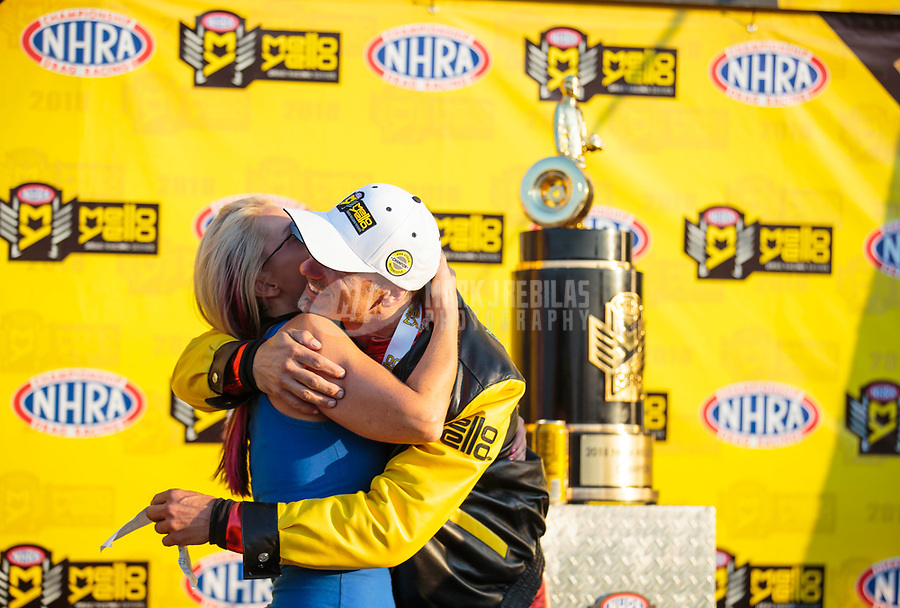 Nov 11, 2018; Pomona, CA, USA; NHRA pro stock motorcycle rider Matt Smith celebrates with wife Angie Smith after clinching the 2018 world championship during the Auto Club Finals at Auto Club Raceway. Mandatory Credit: Mark J. Rebilas-USA TODAY Sports