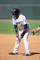 T.J. Williams (4) of the Winston-Salem Dash takes his lead off of first base against the Lynchburg Hillcats at BB&T Ballpark on August 2, 2015 in Winston-Salem, North Carolina.  The Hillcats defeated the Dash 8-3.  (Brian Westerholt/Four Seam Images)