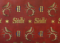 Wall painting with the motto of Nicolas Rolin, Seulle and a star, the initials N and G and a bird on a branch, in the Chapel, in the Salle des Povres or Room of the Poor, in Les Hospices de Beaune, or Hotel-Dieu de Beaune, a charitable almshouse and hospital for the poor, built 1443-57 by Flemish architect Jacques Wiscrer, and founded by Nicolas Rolin, chancellor of Burgundy, and his wife Guigone de Salins, in Beaune, Cote d'Or, Burgundy, France. The hospital was run by the nuns of the order of Les Soeurs Hospitalieres de Beaune, and remained a hospital until the 1970s. The building now houses the Musee de l'Histoire de la Medecine, or Museum of the History of Medicine, and is listed as a historic monument. Picture by Manuel Cohen