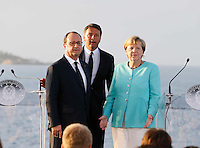 French President, Francoise Hollande ,  Matteo Renzi , prime minister of Italy and German Chancellor Angela Merkel , attends at press conference  on board of Itally's Navy Garibaldi, at the of Italy - France - Germany summit in Ventotene Island 22 August 2016