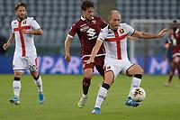 16th July 2020; Olympic Grande Torino Stadium, Turin, Piedmont, Italy; Serie A Football, Torino versus Genoa; Masiello holds off the challenge of Simone Verdi of Torino FC