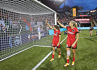 Portland, Oregon - Wednesday June 22, 2016: Portland Thorns FC midfielder Tobin Heath (17) and Portland Thorns FC midfielder Allie Long (10) wave to the crowd after a regular season National Women's Soccer League (NWSL) match at Providence Park.