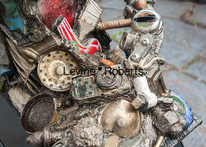 """Detail of """"DNA Totem"""" by the artist Suprina Kenney in Marcus Garvey (Mount Morris) Park in Harlem in New York on Saturday, April 2, 2016. The 9-foot tall public sculpture represents a strand of DNA and is made of steel in which the artist has embedded discarded objects that she has found on the streets. The sculpture will be on view until September 30, 2016.  (© Richard B. Levine)"""