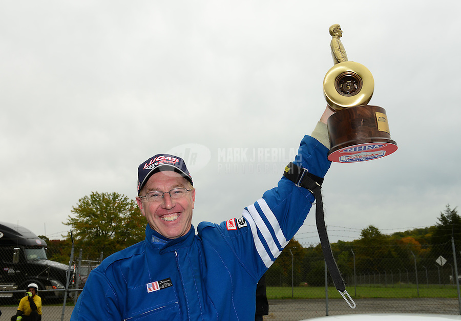 Oct. 8, 2012; Mohnton, PA, USA: NHRA competition eliminator driver Calvin Hill celebrates after winning the Auto Plus Nationals at Maple Grove Raceway. Mandatory Credit: Mark J. Rebilas-