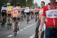 Timothy Dupont (BEL/Roubaix Lille M&eacute;tropole) grabs a musette in the feed zone showing some road rash from an earlier crash<br /> <br /> stage 2<br /> Euro Metropole Tour 2014 (former Franco-Belge)