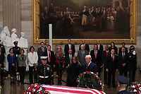 U.S. President Donald Trump and First Lady Melania Trump pay their respects at the casket of former U.S. President George H.W. Bush as it lies in state inside the U.S. Capitol Rotunda on Capitol Hill in Washington, U.S., December 3, 2018. <br /> CAP/MPI/RS<br /> &copy;RS/MPI/Capital Pictures