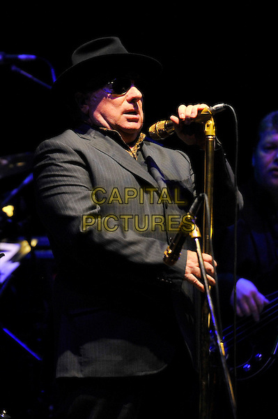 Van Morrison .performing live in concert,  Hammersmith Apollo, London, England. 29th June 2012..music live on stage concert gig half length black hat sunglasses microphone singing grey gray suit jacket .CAP/MAR.© Martin Harris/Capital Pictures.
