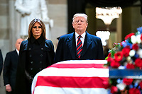 US President Donald J. Trump (R) and his wife, Melania (L), pay respects to former President George H.W. Bush as he lies in state in the Rotunda of the US Capitol in Washington, DC, USA, 03 December 2018. President Bush died at the age of 94 on 30 November 2018; he was the 41st President of the United States <br /> CAP/MPI/RS<br /> &copy;RS/MPI/Capital Pictures