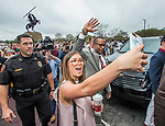 A Florida State University fan takes a selfie as Willie Taggart passes by on his way to being introduced as FSU's new NCAA college football coach in Tallahassee, Fla., Wed, Dec. 6, 2017. (AP Photo/Mark Wallheiser)