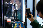 A visitor take a picture of an action figure on display during the AnimeJapan 2017 at Tokyo Big Sight on March 25, 2017, Tokyo, Japan. AnimeJapan 2017 is a trade show promoting ''Everything Anime'' to local and foreign fans and businesses. The show is held over four-day days with March 23-24 reserved for business visitors and March 25-26 for the public. It is expected to attract some 120,000 visitors, including cosplayers. (Photo by Rodrigo Reyes Marin/AFLO)