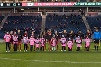 Bridgeview, IL - Saturday March 31, 2018: Portland Thorns FC Starting XI, Player Escorts during a regular season National Women's Soccer League (NWSL) match between the Chicago Red Stars and the Portland Thorns FC at Toyota Park.