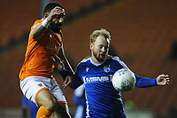 Gillingham's Connor Ogilvie under pressure from Blackpool's Liam Feeney<br /> <br /> Photographer Kevin Barnes/CameraSport<br /> <br /> The EFL Sky Bet League One - Blackpool v Gillingham - Tuesday 11th February 2020 - Bloomfield Road - Blackpool<br /> <br /> World Copyright © 2020 CameraSport. All rights reserved. 43 Linden Ave. Countesthorpe. Leicester. England. LE8 5PG - Tel: +44 (0) 116 277 4147 - admin@camerasport.com - www.camerasport.com