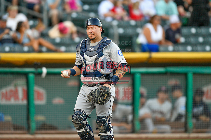 Jesus Sucre (23) of the Tacoma Rainiers on defense against the Salt Lake Bees in Pacific Coast League action at Smith's Ballpark on July 23, 2016 in Salt Lake City, Utah. The Rainiers defeated the Bees 4-1. (Stephen Smith/Four Seam Images)