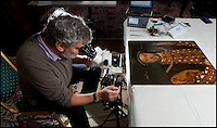 BNPS.co.uk (01202 558833)<br /> Pic: PhilYeomans/BNPS<br /> <br /> Ian Tyers carrying out the study to date the portrait.<br /> <br /> A painting of Henry VIII that has hung in a stately home for over 300 years has soared in value overnight after it was found to be the last portrait created during the King's lifetime.<br /> <br /> Most works of art of the Tudor King were produced after his death and only a handful of contemporary portraits of him exist.<br /> <br /> Up until now the painting owned by Longleat House in Wiltshire was thought to have been a good 'later' copy of the monarch.<br /> <br /> But a painstaking tree-ring dating study of the oak panels the picture is painted on has shown the wood dates to 1529 - when the King was alive and in rude health.
