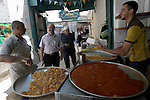 A Palestinian vendor sells the traditional sweets in his shop during the holy month of Ramadan in the West Bank city of Nablus on Aug. 17, 2011. Muslims around the world are observing the holy fasting month of Ramadan in which they refrain from eating, drinking, sex and smoking from dawn to dusk. Photo by Wagdi Eshtayah .