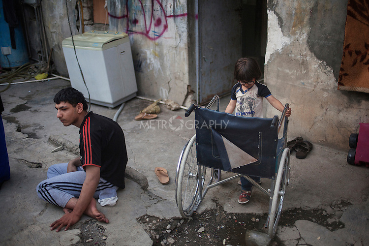21/05/15. Shaqlawa, Iraq. -- Ali (left) 18 y.o. from Falluja is affected by a muscular dystrophy. He needs a wheelchair to move around. He lives with his mother and father, three sisters and two brothers. Othman, 5 y.o. (right), one of Ali's brothers, has a genetic, degenerative condition for which he will loose his sight. It is the same condition that also affects his father. The family lives in an old house, with two rooms and a kitchen for which they pay approximately 400.000 IQD.