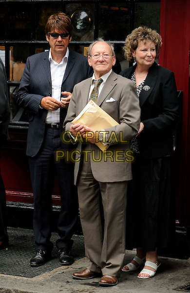 MIKE READ & GUESTS.The Wendy Richard blue plaque unveiling, Shepherd's Tavern, London, England..July 5th, 2009.full length black suit blue beige brown glasses pinstripe reed sunglasses shades .CAP/CAN.©Can Nguyen/Capital Pictures.