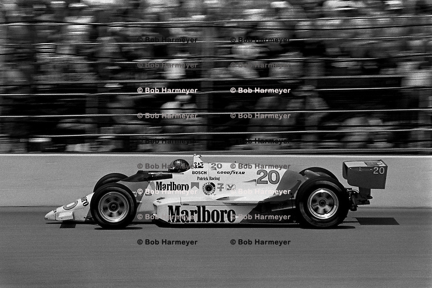 INDIANAPOLIS, IN - MAY 31: Emerson Fittipaldi drives his  March 86C 15/Cosworth during the Indianapolis 500 USAC Indy Car race at the Indianapolis Motor Speedway in Indianapolis, Indiana, on May 31, 1986.