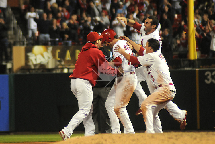 17 May 2011                     Teammates surround St. Louis Cardinals right fielder Lance Berkman (12) after he hit to deep centerfield, scoring the game-winning run in the bottom of the ninth as teammate John Jay scored, moving Albert Pujols to third and Matt Holliday to second. The St. Louis Cardinals defeated the Philadelphia Phillies 2-1 on Tuesday May 17, 2011 in the second game of a two-game series at Busch Stadium in downtown St. Louis.