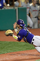 LSU Tigers catcher Tyler Moore #2 makes a diving catch of a pop foul during the Southeastern Conference baseball game against the Georgia Bulldogs on March 22, 2014 at Alex Box Stadium in Baton Rouge, La. The Tigers defeated the Bulldogs 2-1. (Andrew Woolley/Four Seam Images)