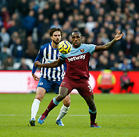 1st February 2020; London Stadium, London, England; English Premier League Football, West Ham United versus Brighton and Hove Albion; Michail Antonio of West Ham United gets to the ball ahead of Davy Propper of Brighton and Hove Albion