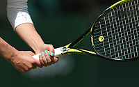 A close-up of the grip of Aliaksandra Sasnovich (BLR) during her match against Simona Halep (ROU) in their Ladies' Singles First Round match<br /> <br /> Photographer Rob Newell/CameraSport<br /> <br /> Wimbledon Lawn Tennis Championships - Day 1 - Monday 1st July 2019 -  All England Lawn Tennis and Croquet Club - Wimbledon - London - England<br /> <br /> World Copyright © 2019 CameraSport. All rights reserved. 43 Linden Ave. Countesthorpe. Leicester. England. LE8 5PG - Tel: +44 (0) 116 277 4147 - admin@camerasport.com - www.camerasport.com