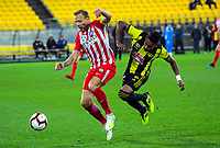 Melbourne's Ritchie De Laet holds off Roy Krishna during the A-League football match between Wellington Phoenix and Melbourne City FC at Westpac Stadium in Wellington, New Zealand on Sunday, 21 April 2019. Photo: Dave Lintott / lintottphoto.co.nz