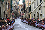 Fans wait for the race to tackle the final climb of Via Santa Caterina in Siena during the 2017 Strade Bianche running 175km from Siena to Siena, Tuscany, Italy 4th March 2017.<br /> Picture: Eoin Clarke | Newsfile<br /> <br /> <br /> All photos usage must carry mandatory copyright credit (&copy; Newsfile | Eoin Clarke)
