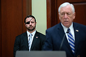 United States Representative Dan Crenshaw (Republican of Texas) listens to United States House Majority Leader Steny Hoyer (Democrat of Maryland) as he speaks during a press conference on International Holocaust Remembrance Day at the United States Capitol in Washington D.C., U.S., on Monday, January 27, 2020.<br />  <br /> Credit: Stefani Reynolds / CNP