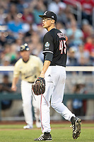 Louisville Cardinals pitcher Luke Smith (45) yells towards the Vanderbilt Commodores bench following the eighth inning of Game 12 of the NCAA College World Series on June 21, 2019 at TD Ameritrade Park in Omaha, Nebraska. Vanderbilt defeated Louisville 3-2. (Andrew Woolley/Four Seam Images)