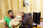 Alix Shattuck, Director of the Pregnancy Aid Clinic in Hapeville, Georgia, talks to Sequoia Tonge who holds her baby Selea Moore, 2 months, before a class at the clinic which offers women free support, including ultrasounds, pregnancy tests, classes, and supplies. Seen November 7, 2013. Sequoia first found out she was pregnant at the clinic.