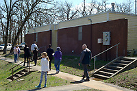 NWA Democrat-Gazette/ANDY SHUPE<br /> Members of the Fayetteville Housing Authority Board of Directors and members of the public speak Friday, March 30, 2018, during a tour of Lewis Plaza in Fayetteville. The board this year has to come up with a capital improvements plan, per U.S. Department of Housing and Urban Development regulations.