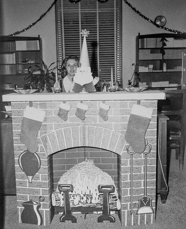 Rep. Wright Patman, D-Tx., office Christmas fireplace decoration during Christmas contest. (Photo by CQ Roll Call via Getty Images)