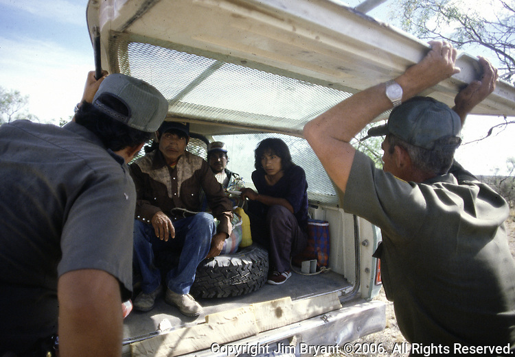 Two U.S. Border Patrol agenst in Del Rio, Texas, gets ready to transports a group of illegal aliens back to the Val Verde Country Jail for processing.  While the traditional mission of the United States Border Patrol has always been the detection and prevention of the illegal entry of aliens and smuggling of illegal contraband into the United States anywhere other than a designated port-of-entry, the dawn of the age of terrorism within our nation has added a new and high priority mission: to detect and prevent the entry of terrorists and their weapons into the United States. Jim Bryant Photo..©2006. All Rights Reserved.