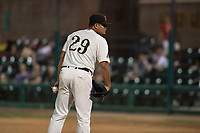 Visalia Rawhide relief pitcher Junior Garcia (29) looks to his catcher for the sign during a California League game against the Stockton Ports at Visalia Recreation Ballpark on May 8, 2018 in Visalia, California. Stockton defeated Visalia 6-2. (Zachary Lucy/Four Seam Images)