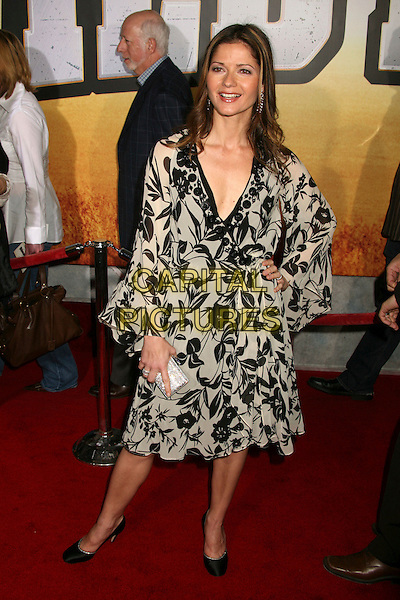 "JILL HENNESSY.""Wild Hogs"" Los Angeles Premiere at the El Capitan Theatre, Hollywood, California, USA..February 27th, 2007.full length black white dress floral print hand on hip clutch purse .CAP/ADM/BP.©Byron Purvis/AdMedia/Capital Pictures"