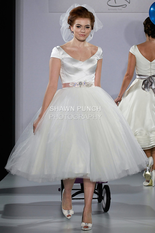 Model walks runway in a Faith wedding dress from the Matty by Matthew Christopher Spring 2013 collection, at the Couture Show, during New York Bridal Fashion Week Spring 2013.