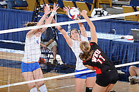 22 November 2008:  New Orleans outside hitter Dobrilla Kovacevic (8) and middle blocker Kaley Hubbard (4) attempt to block a shot during the WKU 3-0 victory over New Orleans in the championship game of the Sun Belt Conference tournament at U.S. Century Bank Arena in Miami, Florida.