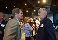 NWA Democrat-Gazette/BEN GOFF @NWABENGOFF<br /> Clayton Marsh (left), founding head of the Thaden School, talks with Bob Ford, artistic director with Theatre Squared,  Monday, June 12, 2017, during a reception hosted by the Walton Family Foundation at Record in downtown Bentonville. Members of the Walton family talked about their vision for the foundation's future work in Northwest Arkansas and abroad.