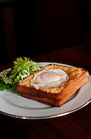 A croque-madame sandwich at a French cafe.