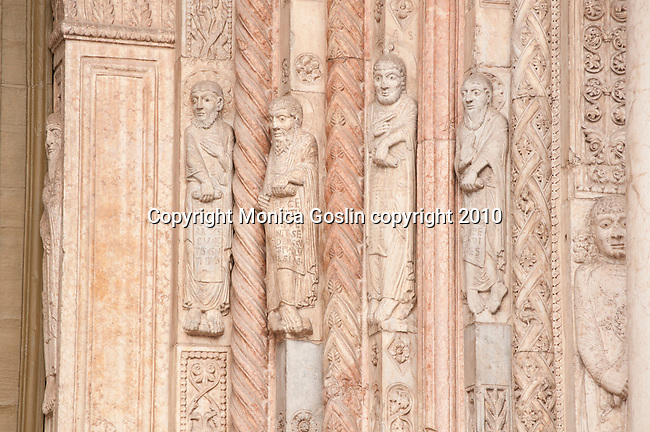 Detail of figures on the facade of the Duomo, Cathedral in Verona, Italy. Cathedral of Verona, Italy. Detail of figures around the door of the Duomo, Cathedral of Verona, Italy.