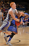 SIOUX FALLS, SD - MARCH 11:  Tony Fiegen #34 of South Dakota State gets tangled with Isaiah McCray #11 of IPFW during their semi-final game at the 2013 Summit League Basketball Championships Monday at the Sioux Falls Arena.  (Photo by Dick Carlson/Inertia)