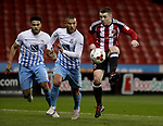 John Fleck of Sheffield United in action with Marcus Tudgay of Coventry City during the English League One match at the Bramall Lane Stadium, Sheffield. Picture date: April 5th, 2017. Pic credit should read: Jamie Tyerman/Sportimage