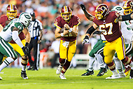 Landover, MD - August 16, 2018: Washington Redskins quarterback Colt McCoy (12) runs the football for a short gain during preseason game between the New York Jets and Washington Redskins at FedEx Field in Landover, MD. (Photo by Phillip Peters/Media Images International)